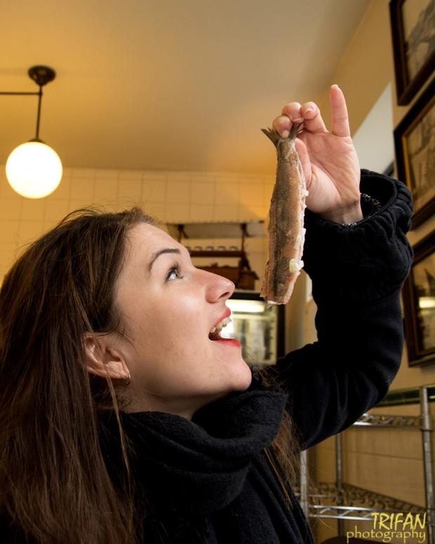 Annamaria eating herring Amsterdam