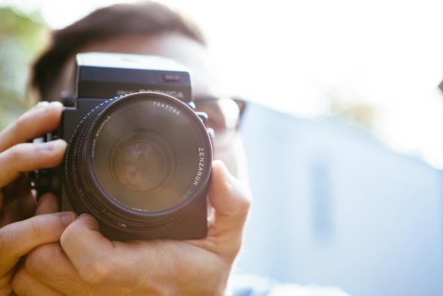 man-person-camera-taking-photo