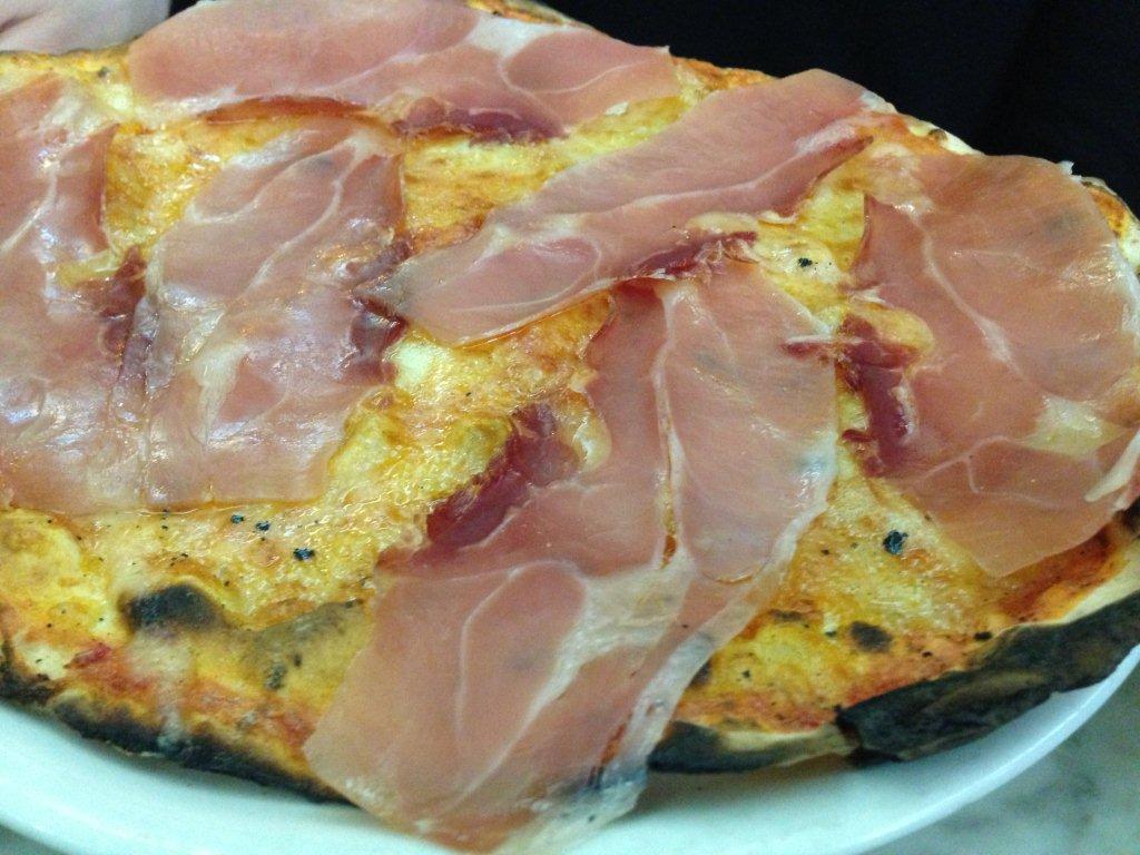 Classic prosciutto pizza at Ai Marmi