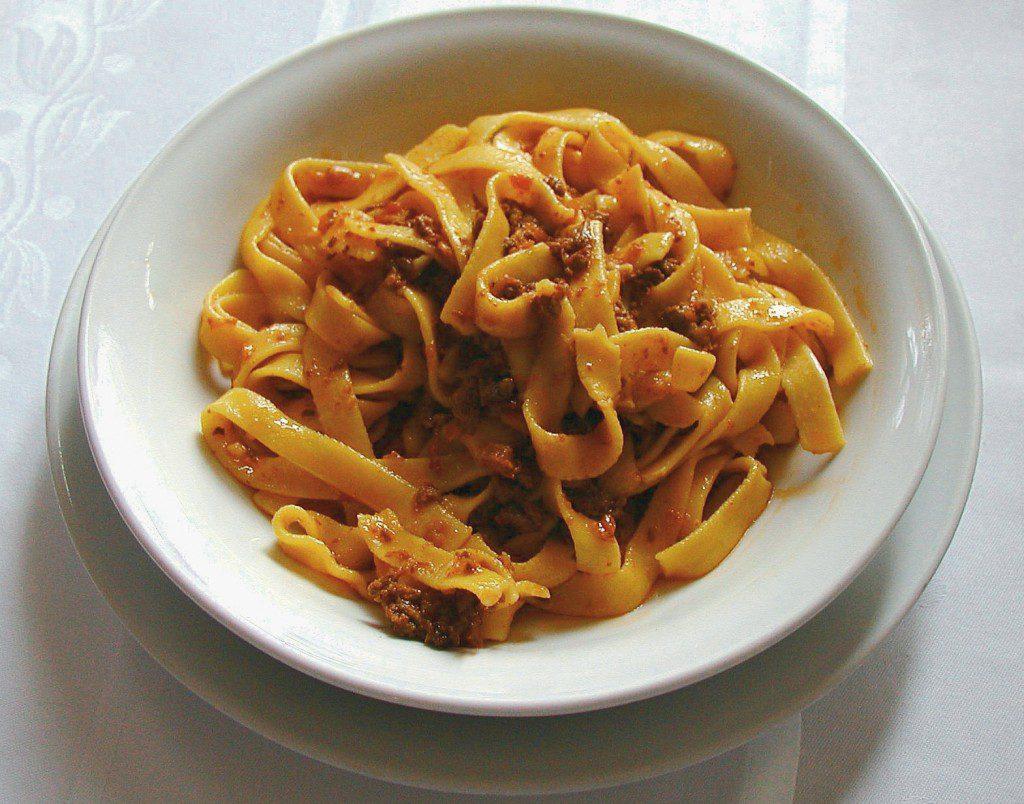 A hearty dish of fettucine con ragu.