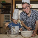 Chef and little girl baking